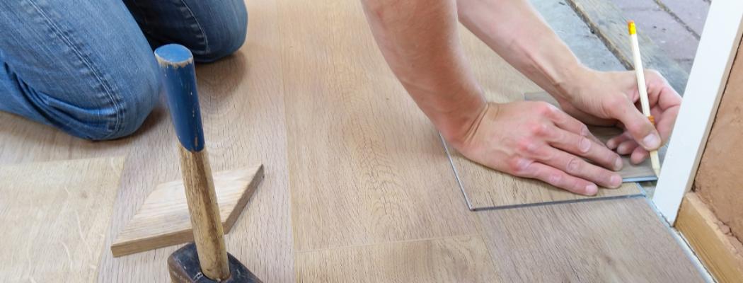 Contractor Installing Luxury Vinyl Plank on Floor