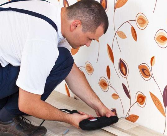 man installing wood floor