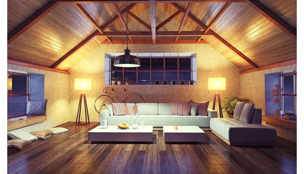 dark wood floors in bedroom with vaulted ceilings