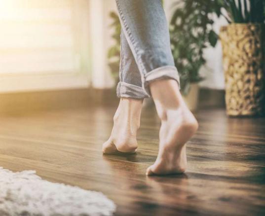girl walking on hardwood floor barefoot
