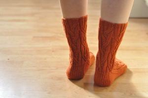 person wearing socks on hardwood flooring