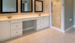 small bathroom with white ceramic til flooring