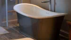 small bathroom with dark luxury vinyl plank flooring